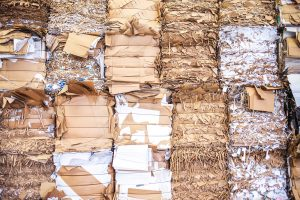 Compacted commercial cardboard waste