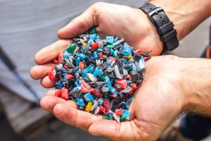 Plastic Waste Recycling - Plastic chippings in hands